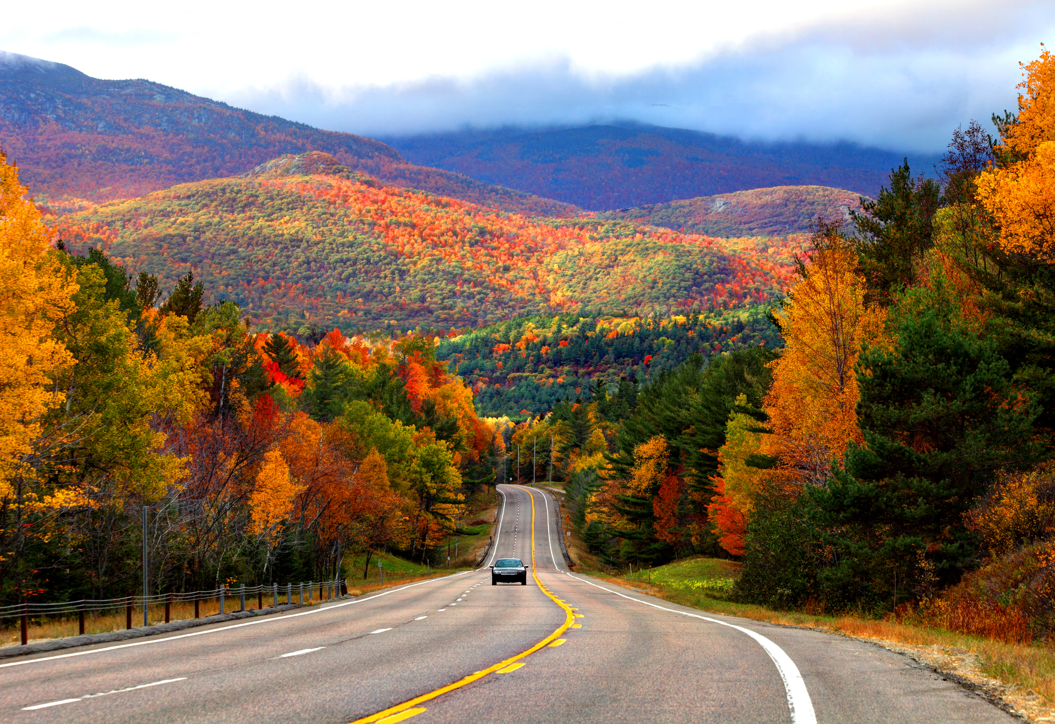 Scenic road in the Adirondacks region of New York during the autumn foliage season