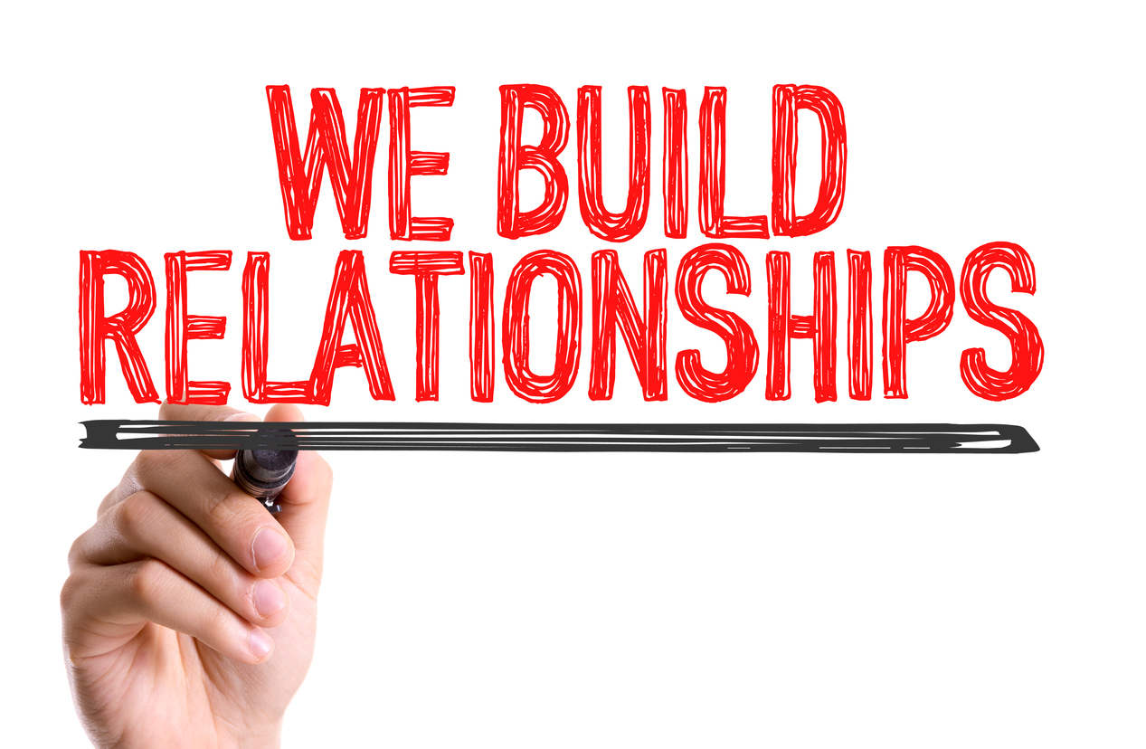 We Build Relationships sign