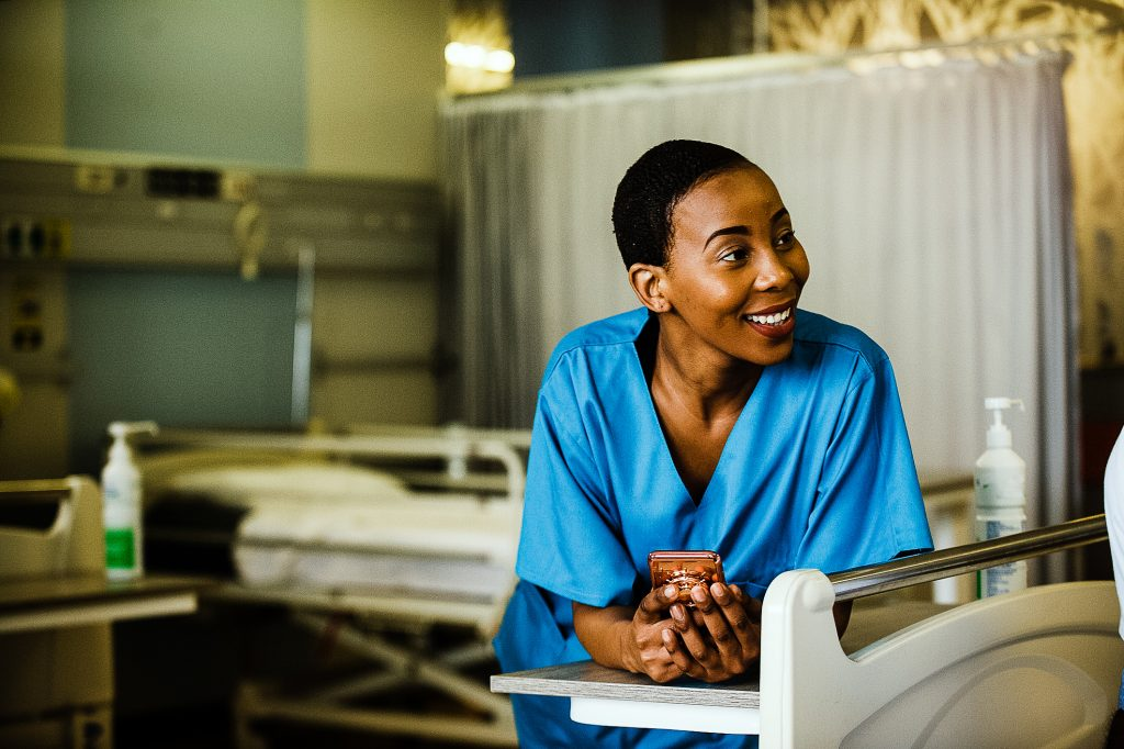 travel nurse using social media at work